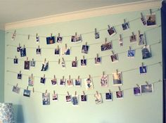 1.Picture Wall: Missing home a little? If you don't want the hassle of taping pictures to a wall, pick a sturdy rope and hang pictures on it with a clothespin.