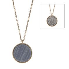 """$12.00 Gold tone necklace displaying a double sided disk with a howlite stone and blue stone. Approximately 32"""" in length."""