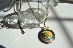 Vintage Brass Locket with Mint Green Rose and Yellow Bow-sweet pendant measures 18 inches.  Hand assembled.