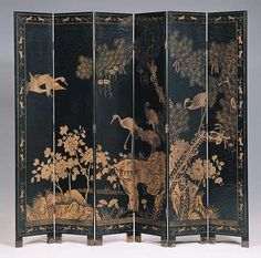 Coromandel Paravent in Black Lacquer with carved birds and foliage and painted with gold leaf