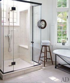 Glass enclosed shower. With a window.