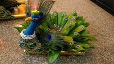 Magnificent Peacock Decor Ideas For Your Wedding Magnificent Peacock Decor Ideas For Your Wedding<br> Check some magnificent peacock decor ideas for your wedding day. This peacock wedding theme will really make your wedding decor elegant and graceful. Diy Diwali Decorations, Diy Wedding Decorations, Flower Decorations, Arti Thali Decoration, Ganapati Decoration, Engagement Ring Platter, Engagement Ring Holders, Coconut Decoration, Peacock Decor