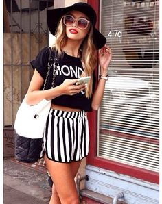 black and white striped pants/t-shirt/floppy hat.
