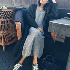 Long grey kitted dress with grey cardigan and black All Stars.