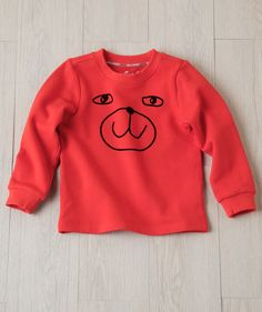 Here's a sweet little funny face for your sweet little funny face. This 100% soft cotton long sleeve t is the perfect play time fit for your little one. Exclusively from Hallmark Baby.