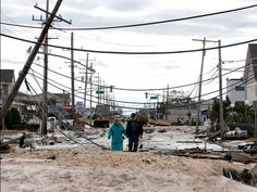 Marcia and Robert Bryce walk through the wreckage along Route 35 on Oct. 31 after Hurricane Sandy slammed into Seaside Heights, N.J.