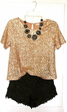 glitter top with black shorts