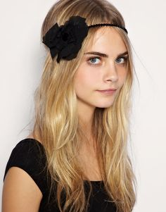 hair like this, but bigger poof and some sort of DIY thing on the head band