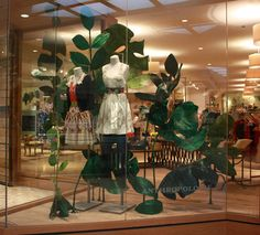 Creating the leaves was very labor intensive—I created enormous wire frames that I covered in wet tissue paper then shellacked to seal in shape. The stems were made from conduit pipe bent into shape and covered in tissue paper. Boutique Interior, Shop Interior Design, Exterior Design, Shop Window Displays, Store Displays, Disney Family, Design Typography, D House, Visual Display