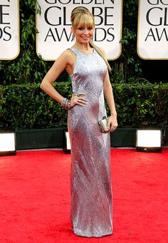 Julien Macdonald gown, Neil Lane jewelry and Jimmy Choo shoes.