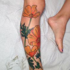 California poppy tattoo. By Holly Ellis at Idle Hands in San Francisco. More realistic though