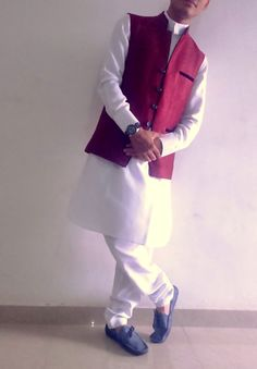 white pathani with maroon nehru cort n blue lofer and fasttrack watch on hand for great look....