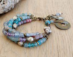 bohemian bracelet - ethnic bracelet - gypsy jewelry - boho bracelet with I ching coin and kuchi charms - blue lilac silver