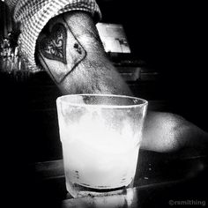 It just so happened that my phone was ready for a quick snapshot when I got up to the bar last night. This bartender's ace-up-the-sleeve tattoo, literally up a sleeve (though not the typical sleeve tattoo), makes an appropriate background for a highball glass alight with a candle. Shot with an iPhone4, processed using Noir and Dynamic Light. Click to check out my blog for more like this every week. Cheers.