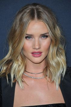 """""""Rosie Huntington-Whiteley has super thick hair, with a long length in the front and layering throughout the crown to give it volume,"""" says Wood, who frequently styles the supermodel. """"It's a great haircut for wavy to straight hair since it softens your waves and adds extra movement."""" By going for a lob with volume cut into it, you simultaneously take weight off your hair while also preserving thickness and natural texture. Although this haircut will naturally enhance the beachy texture…"""