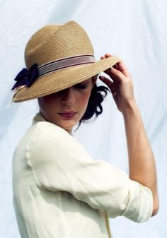Amazingly structured straw hat...look at the curves and the details of this hat.  A show stopper for sure!