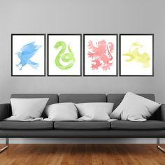 Harry Potter Hogwarts Houses Prints Set of 4. Includes Gryffindor lion, Slytherin snake, Ravenclaw eagle, and Hufflepuff badger silhouettes on a