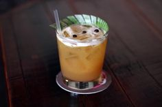 Espresso Bongo 2 ounces amber rum, preferably Barbados 3/4 ounce Simple Syrup 1/2 ounce fresh lime juice 1/2 ounce fresh orange juice 1/2 ounce passion fruit nectar or juice 1/2 ounce chilled brewed espresso 1/4 ounce unsweetened pineapple juice