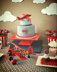 Simple for Leslie to make a larger cake and then use antique plane topper.. ??