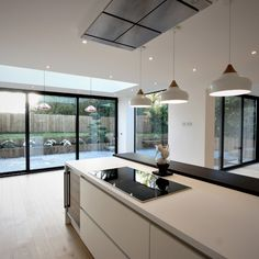installed alongside installations are a fantastic method of overcoming staggered walls. At this property, a large structural glass window was installed to accentuate the White Bifold Doors, Aluminium Sliding Doors, Modern Sliding Doors, Sliding Patio Doors, Sliding Glass Door, Kitchen Patio Doors, Open Plan Kitchen Living Room, Glass Kitchen, Home Decor Kitchen