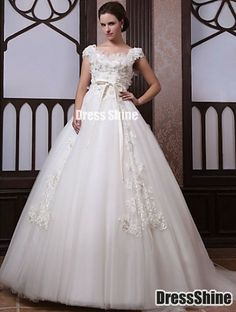 wedding dress, absolutely love the lace on the skirt.