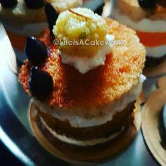 Layered Dessert Entremet flavoured fusion of homemade chocolate cookies, whippedcream with creamcheese and cottagecheese , homemade Orange Tang vegetarian Jelly , vanilla cake sponge with those 3 dots of bubblegum flavoured buttercream and topped with Homemade Malai Peda
