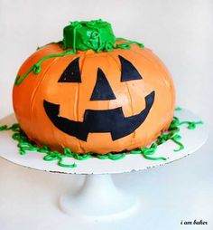 Halloween Pumpkin Cake {Surprise Inside Cake} - Step by step easy tutorial directions.  Older kids could help make this fun cake for Halloween!