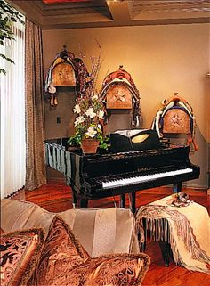 TACKED ON THE WALL: When Houston Interior Designer William Stubbs worked with Carolyn Faulk, lifetime Vice President of the Houston Livestock Show and Rodeo, he knew he wanted to bring a bit of her horsey background into the rooms. Faulk wasn't so sure at first, but Stubb's says when she saw the three saddles he hung near the baby grand, she was hooked. The interior was featured in Stubb's 2004 book, I Hate Red, You re Fired: The Colorful Life of an Interior Designer. Photo: William W…