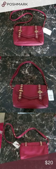 NWT SNOB ESSENTIALS LITTLE RED PURSE Brand new with tags Straps snap together to make it look good to carry on you shoulder or snap to maker shorter handle Pic 4 shows faint black line on purse....it is actually darker but small Snob Essentials Bags