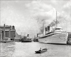 """Circa 1905. """"Along the river at Buffalo, New York. Steamers North Land and City of Erie."""""""