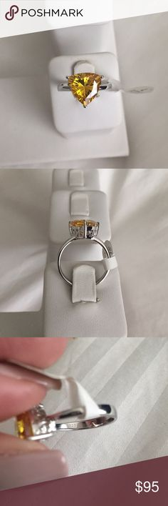 Lab created brilliant citrine on 925 ring Gorgeous Lab created brilliant triangular citrine on 925 ring. Stone is 8mm, very nice size. Shines a lot! Comes in its box. brillante Jewelry Rings