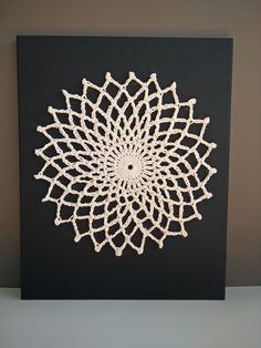 A personal favorite from my Etsy shop https://www.etsy.com/listing/269156479/wall-art-mandala-crochet-wall-hanging