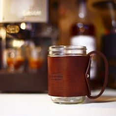 16 oz mason jar hugged in sturdy 10 oz vegetable tanned leather. Handle is also made with 10 oz leather and it's attached with brass rivets so its nice and sturdy. Great for that cup of joe or sweet tea on the go.