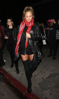 Chrissy Teigen does mommy style flawlessly in thigh high boots and moto leather jacket