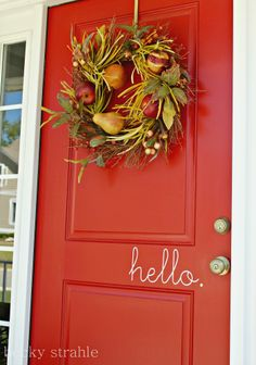 Farmgirl Paints front door:  love the 'hello' cling!!  find it on easy by searching for   'hello' cling