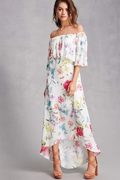 A woven maxi dress by Pretty by Rory™ featuring an allover colorful floral print, an elasticized off-the-shoulder flounce neckline, 3/4 sleeves, and a high-low hem.