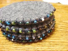 felted wool crafts Beaded wool coasters from re-purposed felted sweaters - tutorial , Felted Wool Crafts, Felt Crafts, Fabric Crafts, Sewing Crafts, Wool Embroidery, Wool Applique, Felt Coasters, Art Textile, Penny Rugs