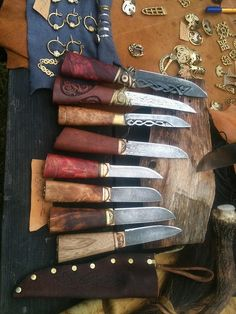Viking knives handmade wood handle, with knot work on the blade. Ol time! Wow I want.