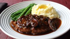 Reminisce on TV dinners with Chef John's version of the all-American favorite, Salisbury steak, with a gravy that's delicious on just about anything.