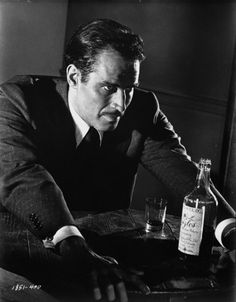 Charlton Heston in Touch Of Evil (1958) He's an honest cop vs. Orson Welles corrupt cop.