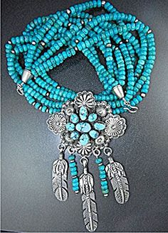 Navajo Sleeping Beauty 18 1/2 inch 5 Strands Sleeping Beauty Turquoise Beads Sterling Silver Beads Spacers Large Sterling Silver 3 Feathers and Sleeping Beauty Dangles Between the 5 1/2 Long 2 3/4 Wide Pendant 240 Grams. Sterling Silver Hook Clasp