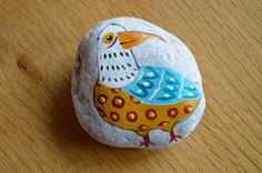 Bird painted in stone by StoneLovers on Etsy