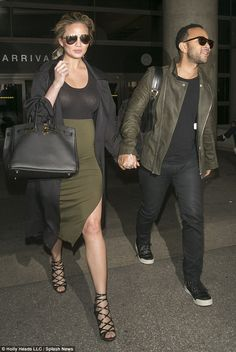 Pregnant Chrissy Teigen sports sheer top at LAX Coordinated couple: Chrissy Teigen and husband John Legend were seen arriving into LAX on Friday after their trip to Morocco Matching Couple Outfits, Matching Couples, Cute Couples, Chrissy Teigen Style, Chrissy Teigen John Legend, Paar Style, Stylish Couple, Photo Couple, Fashion Couple