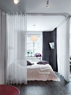 Create A Divided Bedroom With Curtain Rails