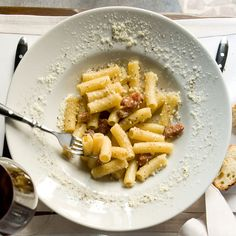 Rigatoni with Pecorino and Crispy Guanciale - Put a spin on gricia, the classic Roman pasta made with guanciale (cured pork jowl) and pecorino cheese. Instead of leaving the guanciale soft, crisp it up, then tops the dish with different kinds of black pepper, including fragrant Malaysian Sarawak. http://www.foodandwine.com/recipes/rigatoni-pecorino-and-crispy-guanciale