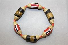 This stretch cord bracelet includes all recycled glass beads made in Ghana, West Africa: red and black beads with cones and small spacers. All proceeds go to help build the Ankaase SDA School computer lab. Size: small (7 inches around.)