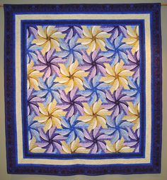 """""""Lesley's Daylilies"""" by Edrene Heiss.  This quilt is primarily hand-pieced.  Quilted by Debbie Bookman.  The pattern is featured in Jinny Beyer's book, """"Quilting by Hand""""."""