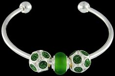 silver plated items: bangle, two enamel glittering beads. One glass bead with 925 silver core.