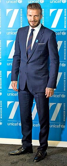 The former soccer star looked dapper in a navy blue suit, topped off with a UNICEF pin on one lapel.