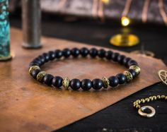 6mm - Matte black onyx beaded stretchy bracelet with bronze accents, made to order gemstone bracelet, mens bracelet, womens bracelet